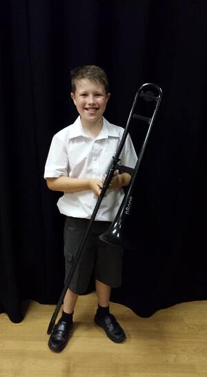 Ethan with his pBone at the Orchestra Concert July 2019