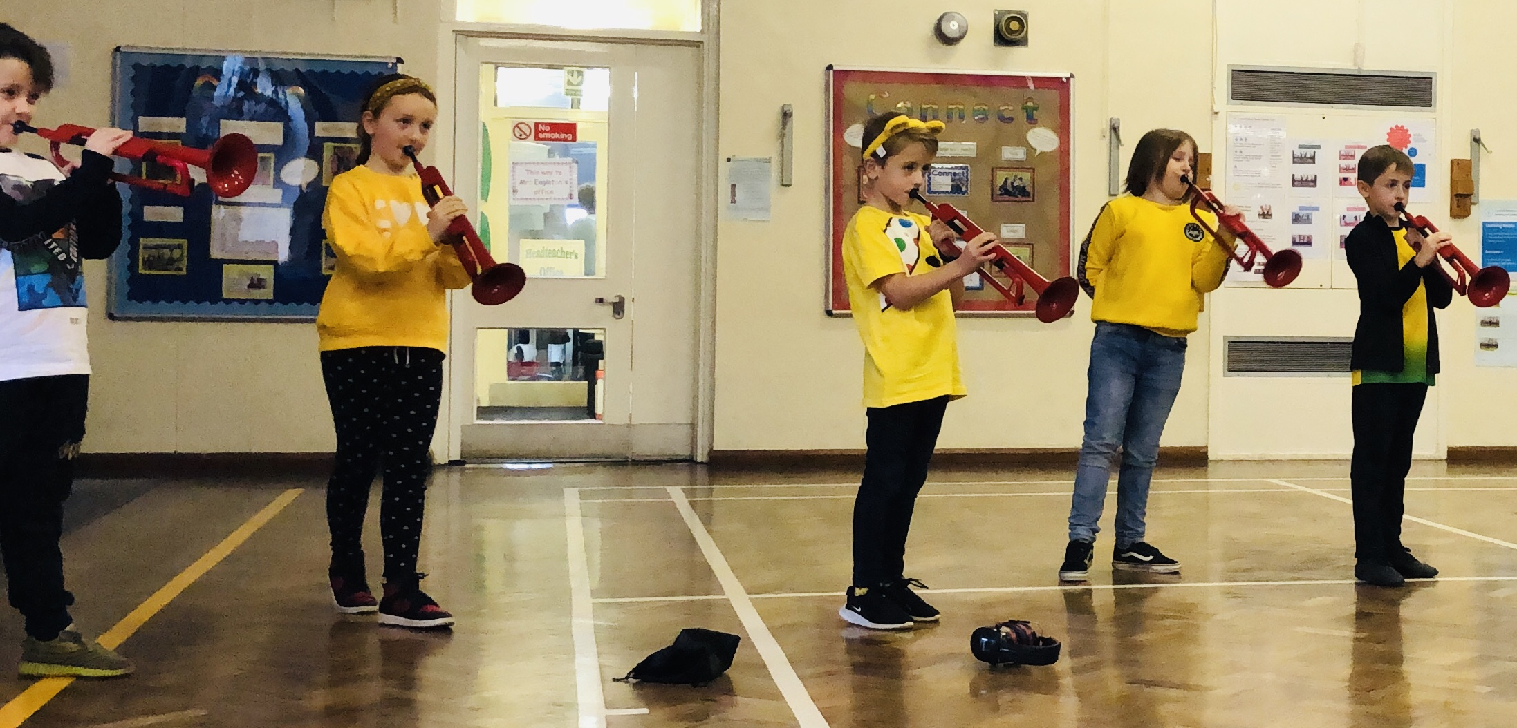 Pupils at Coit Primary School play the pBugle