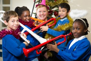 Xmas music. The children from Frederick Bird Primary school, Coventry, have been learning how to play the P instruments. Pictured, from left, Korey Palmer(8), Christiana Ojo (9), Becca Pope from Warwick Music Group, Lukas Taragos (8), Wonder Ehouman (8)